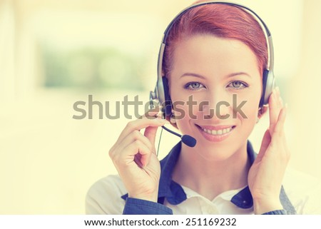 Customer service representative wearing a headset isolated on office windows background