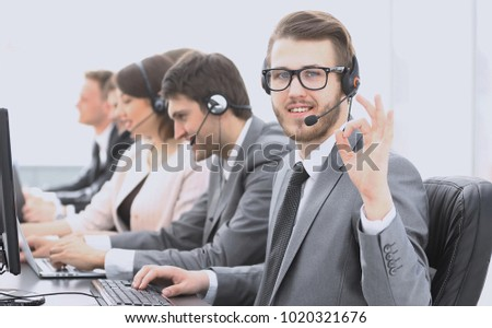 "customer service representative with headset showing sign ""OK"""