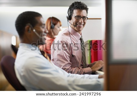 Customer Service Reps in Call Center - stock photo