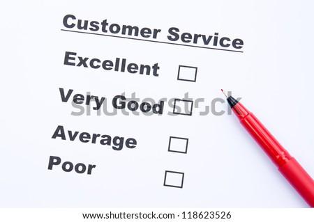 Customer service survey form and pen - stock photo