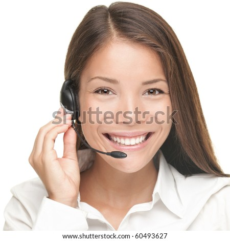 Customer Service woman smiling talking on headset. Close up portrait of beautiful young Caucasian / Asian.