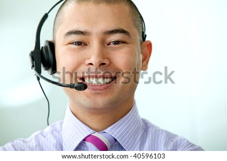 Customer Services man smiling with a headset