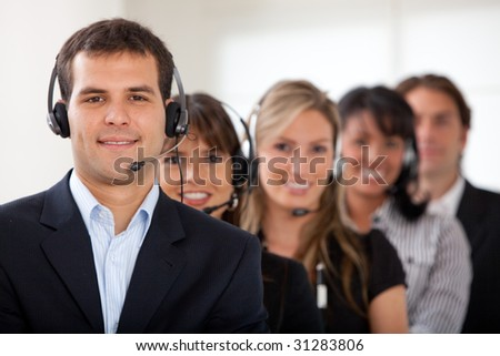 Customer services representative team in an office - stock photo