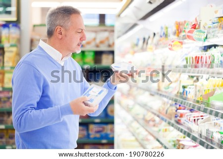 Customer shopping at the supermarket - stock photo