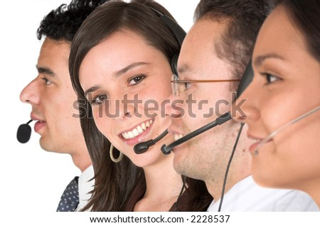 customer suppor team over a white background - focus is on the girl facing the camera - stock photo