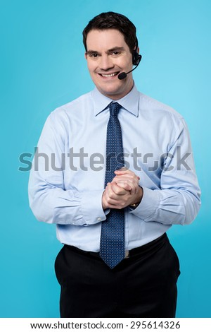 Customer support executive male with clasped hands - stock photo