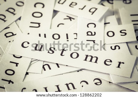 Customer topic in cut paper on the top of the others word