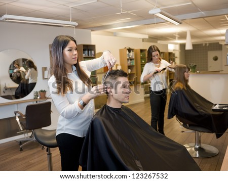 Customers and Hairdressers in the Beauty shop - stock photo