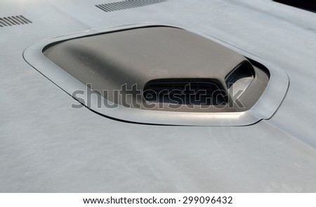Customized car hood at auto show - stock photo