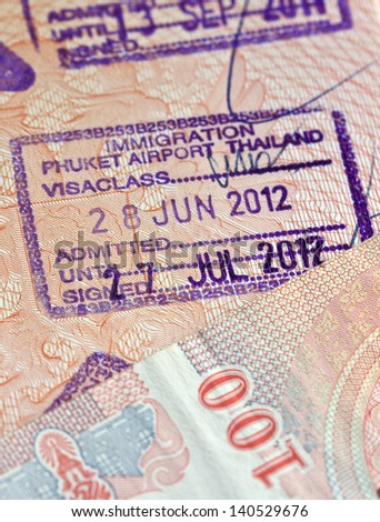 customs stamp  is Airport Phuket Thailand  as a concept tropical vacation - stock photo
