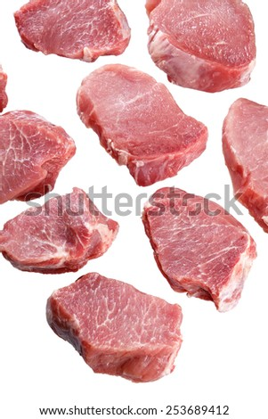 Cut a piece of fresh meat for cooking. Isolated. - stock photo