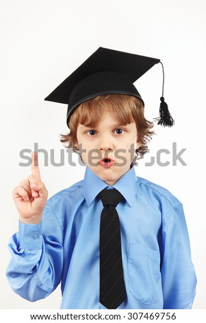 Cut boy in academic hat on a white background - stock photo