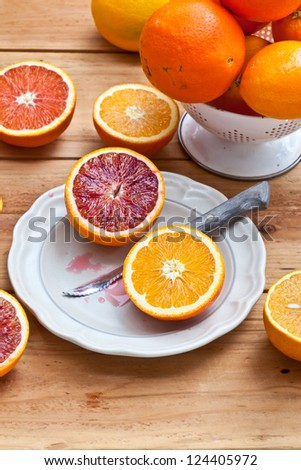 Cut Different Kind of Oranges on plate. Also available in horizontal format. - stock photo