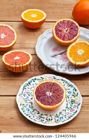 Cut Different Kind of Oranges on plates - stock photo
