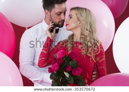 Cut flowers in hands of attractive woman  - stock photo