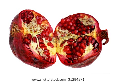 cut fruit of pomegranate on a white background
