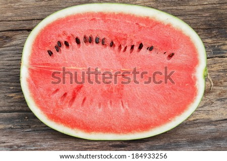 Cut haft red watermelon sweet good test on vintage wooden. - stock photo