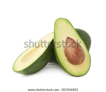 Cut in half avocado fruit composition isolated over the white background - stock photo