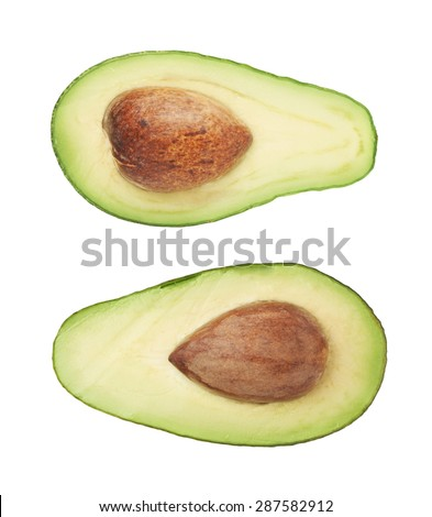 Cut in half open ripe avocado fruit with the pit, isolated over the white background, set of two different foreshortenings - stock photo