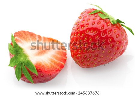 Cut isolated strawberries studio macro photo on white background ready for packaging design and advertising