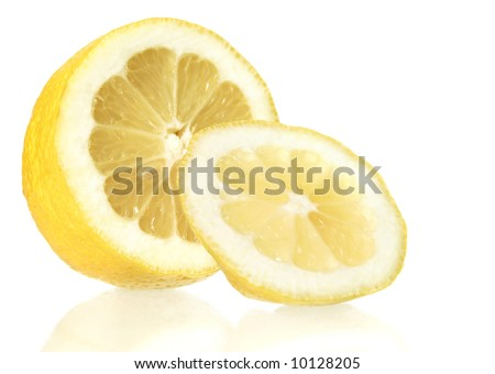 cut lemon and its reflection in glass surface