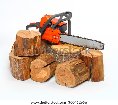 Cut logs fire wood and chainsaw isolated on white background. Renewable resource of a energy. Environmental concept. - stock photo