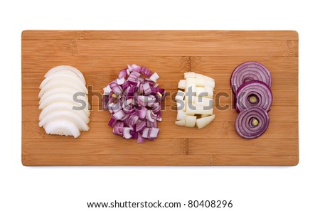 Cut onion on wooden board - stock photo