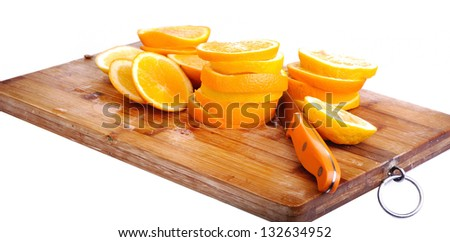 cut oranges on kitchen board, isolated