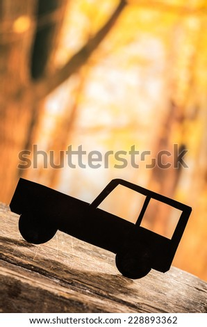 cut out black car silhouette over forest background concept of insurance travel adventure investment - stock photo