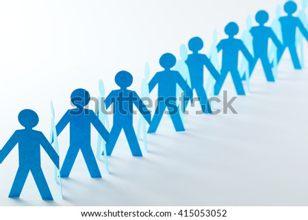 Cut out of blue paper people in chain - stock photo
