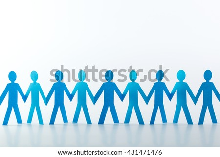 Cut out of blue paper people in chain
