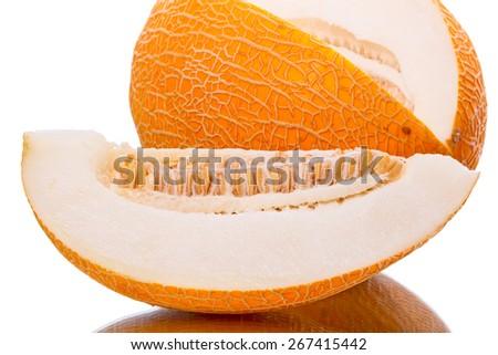 Cut  ripe yellow melon on a white background - stock photo