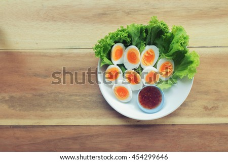 Cut the boiled eggs, which were arranged- tone vintage - stock photo