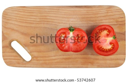 cut tomato on  kitchen board . Isolated over white .