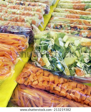 Cut vegetables and wrapped in plastic - mix for salads and soups   - stock photo