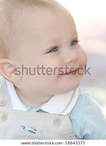 Cute, adorable baby boy with blue eyes and blond hair