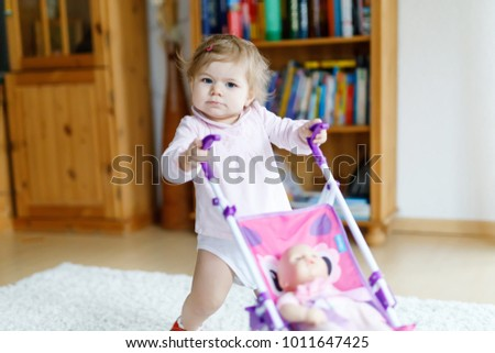 cute adorable baby girl making first stock photo royalty free