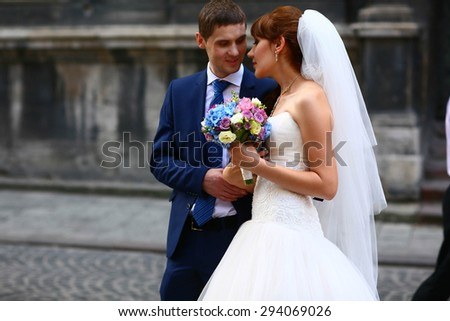 Cute adorable beautiful happy just married couple, stylish bouquet, lviv, summer