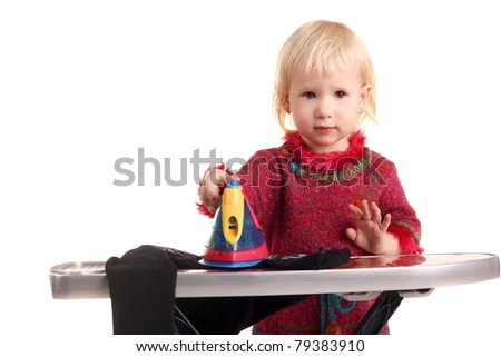 cute adorable blond little child ironing playing