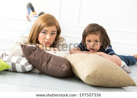 Cute, adorable boy with mother on the floor