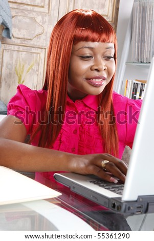 Cute african-american at her desk