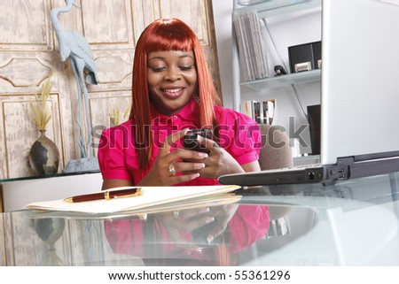 Cute african-american at her desk - stock photo