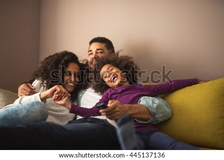 Cute african american family enjoying time together. - stock photo