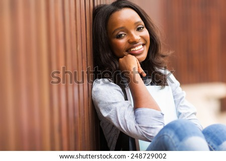 cute african american girl on college campus - stock photo