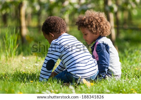 Cute african american little boys  playing outdoor - Black people - stock photo