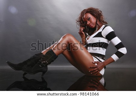 Cute African American on a mirror floor - stock photo