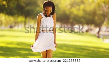 Cute African woman dancing in a park - stock photo