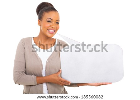 cute african woman holding speech bubble against white background - stock photo