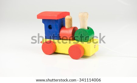Cute and colorful blocks of wooden train. Concept of transportation education for preschool student. Isolated on white background. Slightly de-focused and close-up shot. Copy space. - stock photo