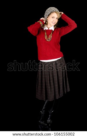 Cute and Fresh Looking Young Beauty in Sweater and Knit Cap.  Isolated on Black. - stock photo